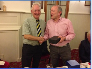 Captain John Gould presents to Tony Mason