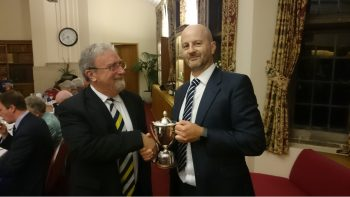 John Butler (captain) presents to the winner, Paul Harrup