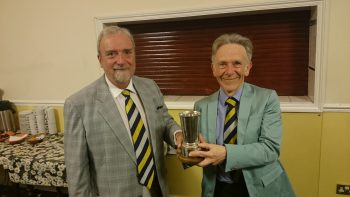 John Butler (captain) presents to Robert Hollidge