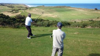 David Hughes and Nigel  Huxtable on Sheringhams signature fifth hole